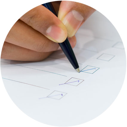 Person ticking a multiple choice document