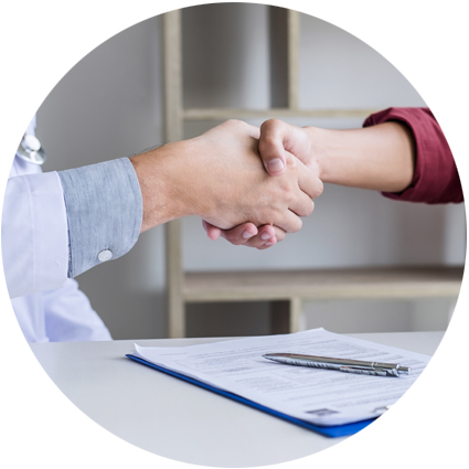 Two people shaking hands after an agreement